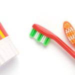 Tooth brush and tooth paste on a white background